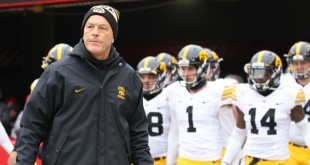Iowa Hawkeyes head coach Kirk Ferentz leads his team on the field before their game with the Nebraska Cornhuskers at Memorial Stadium. Mandatory Credit: Reese Strickland-USA TODAY Sports