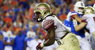 Nov 28, 2015; Gainesville, FL, USA; Florida State Seminoles running back Dalvin Cook (4) runs with the ball against the Florida Gators during the second half at Ben Hill Griffin Stadium. Florida State defeated Florida 27-2. Mandatory Credit: Kim Klement-USA TODAY Sports