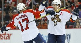 Florida Panthers defenseman Brian Campbell (51) celebrates with center Derek MacKenzie (17) Credit: Rick Osentoski-USA TODAY Sports