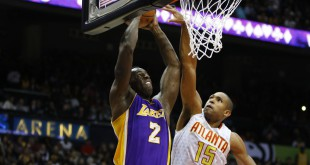Dec 4, 2015; Atlanta, GA, USA; Los Angeles Lakers forward Brandon Bass (2) dunks over Atlanta Hawks center Al Horford (15) in the second quarter at Philips Arena. Mandatory Credit: Brett Davis-USA TODAY Sports