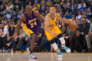 Golden State Warriors guard Stephen Curry (30) dribbles the basketball against Los Angeles Lakers forward Kobe Bryant (24) during the third quarter at Oracle Arena. The Warriors defeated the Lakers 111-77. Mandatory Credit: Kyle Terada-USA TODAY Sports