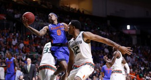 Dec 8, 2015; Coral Gables, FL, USA; Florida Gators guard Kasey Hill (0) drives to the basket as Miami Hurricanes guard James Palmer (12) defends during the first half at BankUnited Center. Mandatory Credit: Steve Mitchell-USA TODAY Sports