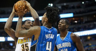 Dec 8, 2015; Denver, CO, USA; Denver Nuggets forward Kenneth Faried (35) struggles to shoot the ball as Orlando Magic guard Elfrid Payton (4) defends during the first half at Pepsi Center. Mandatory Credit: Chris Humphreys-USA TODAY Sports