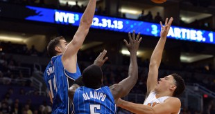 Dec 9, 2015; Phoenix, AZ, USA; Phoenix Suns guard Devin Booker (1) drives the to the basket during the first half of the game against the Orlando Magic guard Victor Oladipo (5) and forward Jason Smith (14) at Talking Stick Resort Arena. Mandatory Credit: Jennifer Stewart-USA TODAY Sports