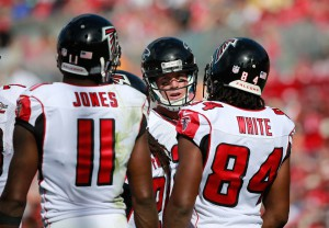 Atlanta Falcons quarterback Matt Ryan (2) talks with wide receiver Julio Jones (11) and wide receiver Roddy White (84) against the Tampa Bay Buccaneers during the first quarter at Raymond James Stadium. Mandatory Credit: Kim Klement-USA TODAY Sports