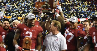 Alabama coach Nick Saban and MVP Derrick Henry (2) stand on the podium as the 2015 SEC Champions after defeating the Florida Gators 29-15. (Greenberry Taylor/ WUFT News)