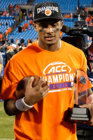 Dec 5, 2015; Charlotte, NC, USA; Clemson Tigers quarterback Deshaun Watson (4) walks off the field with the MVP trophy after the ACC football championship game at Bank of America Stadium. The Tigers won 45-37. Mandatory Credit: Jim Dedmon-USA TODAY Sports