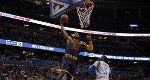 Mar 15, 2015; Orlando, FL, USA; Cleveland Cavaliers forward LeBron James (23) dunks over Orlando Magic guard Victor Oladipo (5) during the second quarter at Amway Center. Mandatory Credit: Kim Klement-USA TODAY Sports