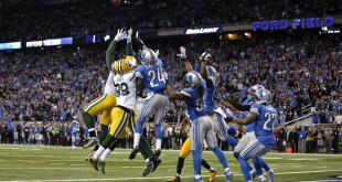 Dec 3, 2015; Detroit, MI, USA; Green Bay Packers quarterback Aaron Rodgers (not pictured) completes a touchdown pass to tight end Richard Rodgers (82) during the fourth quarter with no time remaining against the Detroit Lions at Ford Field. Mandatory Credit: Raj Mehta-USA TODAY Sports