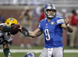 Dec 3, 2015; Detroit, MI, USA; Green Bay Packers outside linebacker Julius Peppers (56) strips the ball away from Detroit Lions quarterback Matthew Stafford (9) during the third quarter at Ford Field. Packers win 27-23. Mandatory Credit: Raj Mehta-USA TODAY Sports