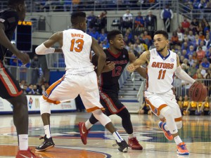 Jan 2, 2016; Gainesville, FL, USA; Florida Gators guard Chris Chiozza (11) dribbles the ball as Georgia Bulldogs guard Kenny Gaines (12) defends in the first half at Stephen C. O'Connell Center. Mandatory Credit: Logan Bowles-USA TODAY Sports