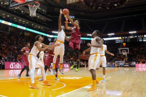 Jan 23, 2016; Knoxville, TN, USA; South Carolina Gamecocks guard PJ Dozier (15) shoots against Tennessee Volunteers forward Ray Kasongo (2)during the first half at Thompson-Boling Arena. Mandatory Credit: Randy Sartin-USA TODAY Sports
