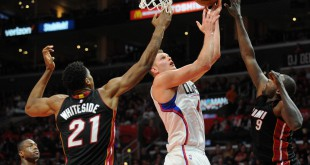 January 13, 2016; Los Angeles, CA, USA; Los Angeles Clippers center Cole Aldrich (45) moves in for a basket against Miami Heat center Hassan Whiteside (21) and forward Luol Deng (9) during the second half at Staples Center. Mandatory Credit: Gary A. Vasquez-USA TODAY Sports