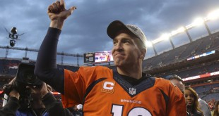Jan 24, 2016; Denver, CO, USA; Denver Broncos quarterback Peyton Manning (18) gives a thumbs up to the fans after the AFC Championship football game at Sports Authority Field at Mile High. Denver Broncos defeated New England Patriots 20-18 to earn a trip to Super Bowl 50. Mandatory Credit: Chris Humphreys-USA TODAY Sports