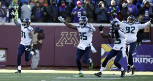 Jan 10, 2016; Minneapolis, MN, USA; Seattle Seahawks players including Kam Chancellor (31) , DeShawn Shead (35) , Richard Sherman (25) and Brandon Mebane (92) celebrate after Minnesota Vikings kicker Blair Walsh (not pictured) missed a field goal in the fourth quarter in a NFC Wild Card playoff football game at TCF Bank Stadium. Mandatory Credit: Bruce Kluckhohn-USA TODAY Sports