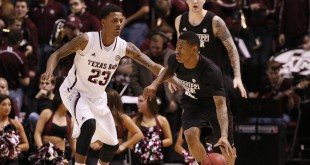 Feb 5, 2014; College Station, TX, USA; Mississippi State Bulldogs guard Trivante Bloodman (4) dribbles the ball as Texas A&M Aggies guard Jamal Jones (23) defends during the second half at Reed Arena. The Aggies won 72-52. Mandatory Credit: Soobum Im-USA TODAY Sports