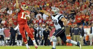 Sep 29, 2014; Kansas City, MO, USA; Kansas City Chiefs quarterback Alex Smith (11) throws a touchdown pass as New England Patriots defensive end Rob Ninkovich (50) tries to block during the second half at Arrowhead Stadium. The Chiefs won 41-14. Mandatory Credit: Denny Medley-USA TODAY Sports