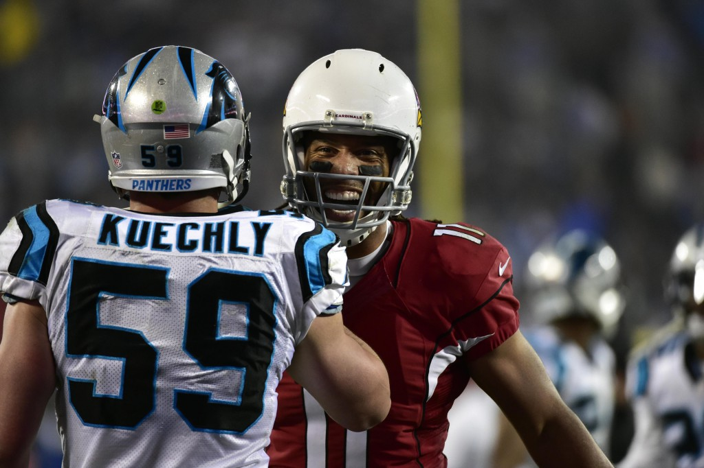 Jan 3, 2015; Charlotte, NC, USA; Arizona Cardinals wide receiver Larry Fitzgerald (11) talks to Carolina Panthers middle linebacker Luke Kuechly (59) during the second quarter in the 2014 NFC Wild Card playoff football game at Bank of America Stadium. Mandatory Credit: Bob Donnan-USA TODAY Sports