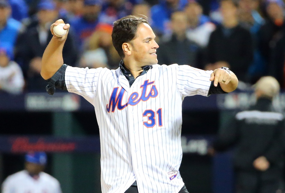 Oct 30, 2015; New York City, NY, USA; New York Mets former catcher Mike Piazza throws out the ceremonial first pitch before game three of the World Series against the Kansas City Royals at Citi Field. Mandatory Credit: Anthony Gruppuso-USA TODAY Sports