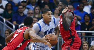 Nov 6, 2015; Orlando, FL, USA; Orlando Magic forward Tobias Harris (12) drives through Toronto Raptors guard Kyle Lowry (7) and forward Anthony Bennett (15) during the second quarter of a basketball game at Amway Center. Mandatory Credit: Reinhold Matay-USA TODAY Sports