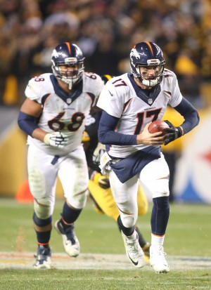 Dec 20, 2015; Pittsburgh, PA, USA; Denver Broncos quarterback Brock Osweiler (17) scrambles with the ball against the Pittsburgh Steelers during the fourth quarter at Heinz Field. The Steelers won 34-27. Mandatory Credit: Charles LeClaire-USA TODAY Sports