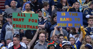 "St. Louis, MO, USA; St. Louis Rams fans hold signs that read ""All I want for Christmas is for the Rams to stay in St. Louis"" in reference to the team's proposed relocation to Los Angeles during an NFL football game against the Tampa Bay Buccaneers at the Edward Jones Dome. Mandatory Credit: Kirby Lee-USA TODAY Sports"