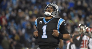 Jan 3, 2016; Charlotte, NC, USA; Carolina Panthers quarterback Cam Newton (1) reacts after scoring in the third quarter. The Panthers defeated the Buccaneers 31-10 at Bank of America Stadium. Mandatory Credit: Bob Donnan-USA TODAY Sports