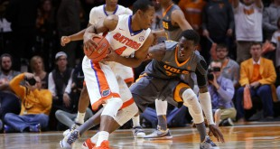 Jan 6, 2016; Knoxville, TN, USA; Florida Gators guard KeVaughn Allen (4) moves the ball against Tennessee Volunteers guard Devon Baulkman (34) during the first half at Thompson-Boling Arena. Mandatory Credit: Randy Sartin-USA TODAY Sports