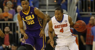Jan 9, 2016; Gainesville, FL, USA;Florida Gators guard KeVaughn Allen (4) drives to the basket as LSU Tigers forward Craig Victor II (32) defends during the first half at Stephen C. O'Connell Center. Mandatory Credit: Kim Klement-USA TODAY Sports