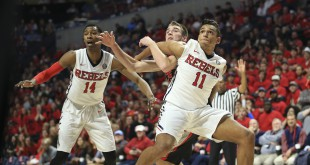 Jan 9, 2016; Oxford, MS, USA; Mississippi Rebels forward Sebastian Saiz (11) blocks out Georgia Bulldogs forward Kenny Paul Geno (25) during a free throw attempt by the Georgia Bulldogs at The Pavilion at Ole Miss. The Rebels won 72-71. Mandatory Credit: Spruce Derden-USA TODAY Sports