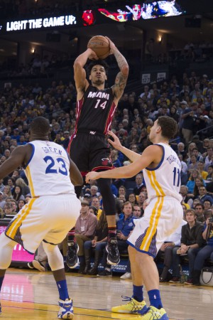 January 11, 2016; Oakland, CA, USA; Miami Heat forward Gerald Green (14) shoots the basketball against Golden State Warriors forward Draymond Green (23) and guard Klay Thompson (11) during the second quarter at Oracle Arena. Mandatory Credit: Kyle Terada-USA TODAY Sports