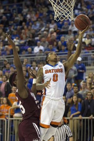 Jan 19, 2016; Gainesville, FL, USA; Florida Gators guard Kasey Hill (0) takes a shot as Mississippi State Bulldogs forward Aric Holman (right) defends in the second half at Stephen C. O'Connell Center. The Florida Gators won 81-78. Mandatory Credit: Logan Bowles-USA TODAY Sports