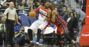 Jan 20, 2016; Washington, DC, USA; Washington Wizards center Nene Hilario (42) drives to the basket as Miami Heat forward Chris Bosh (1) defends during the first quarter at Verizon Center. Mandatory Credit: Tommy Gilligan-USA TODAY Sports