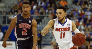 Jan 23, 2016; Gainesville, FL, USA; Florida Gators guard Chris Chiozza (11) drives down court past Auburn Tigers guard Bryce Brown (2) during the first half of a basketball game at Stephen C. O'Connell Center. Mandatory Credit: Reinhold Matay-USA TODAY Sports