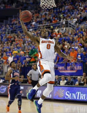 Jan 23, 2016; Gainesville, FL, USA; Florida Gators guard Kasey Hill (0) drives to the basket for the dunk during the second half of a basketball game against the Auburn Tigers at Stephen C. O'Connell Center. The Gators won 95-63. Mandatory Credit: Reinhold Matay-USA TODAY Sports