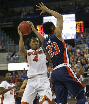 Jan 23, 2016; Gainesville, FL, USA; Florida Gators guard KeVaughn Allen (4) shoots over Auburn Tigers guard TJ Lang (23) during the second half of a basketball game at Stephen C. O'Connell Center. The Gators won 95-63. Mandatory Credit: Reinhold Matay-USA TODAY Sports