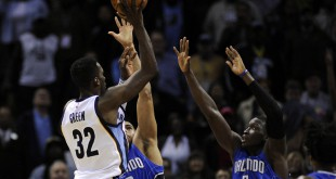 Jan 25, 2016; Memphis, TN, USA; Memphis Grizzlies forward Jeff Green (32) shoots over Orlando Magic guard Victor Oladipo (5) during the second half at FedExForum. Memphis Grizzlies defeated the Orlando Magic in overtime 108-102. Mandatory Credit: Justin Ford-USA TODAY Sports