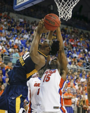 Jan 30, 2016; Gainesville, FL, USA; West Virginia Mountaineers forward Devin Williams (41) shoots as Florida Gators center John Egbunu (15) defends during the second half of a basketball game at the Stephen C. O'Connell Center. Florida won 88-71. Mandatory Credit: Reinhold Matay-USA TODAY Sports