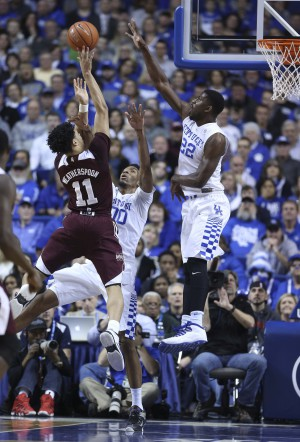 Jan 12, 2016; Lexington, KY, USA; Mississippi State Bulldogs guard Quinndary Weatherspoon (11) shoots the ball against Kentucky Wildcats forward Alex Poythress (22) and forward Marcus Lee (0) in the second half at Rupp Arena. Kentucky defeated Mississippi State 80-74. Mandatory Credit: Mark Zerof-USA TODAY Sports