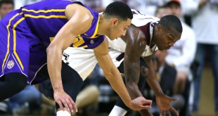 Jan 19, 2016; College Station, TX, USA; Louisiana State Tigers forward Ben Simmons (25) goes for a loose ball against Texas A&M Aggies forward Jalen Jones (12) during the first half at Reed Arena. Mandatory Credit: Erich Schlegel-USA TODAY Sports