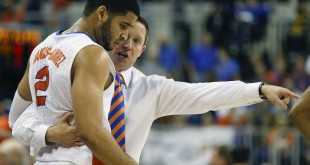 Jan 30, 2016; Gainesville, FL, USA; Florida Gators head coach Mike White talks with guard Brandone Francis-Ramirez (2) during the first half of a basketball game against the West Virginia Mountaineers at the Stephen C. O'Connell Center. Mandatory Credit: Reinhold Matay-USA TODAY Sports