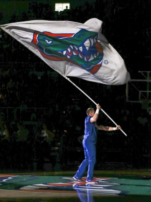 Jan 30, 2016; Gainesville, FL, USA; A Florida Gators cheerleader waves the Gators flag before the first half of a basketball game against the West Virginia Mountaineers at the Stephen C. O'Connell Center. Mandatory Credit: Reinhold Matay-USA TODAY Sports