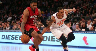 Feb 28, 2016; New York, NY, USA; Miami Heat small forward Joe Johnson (2) grabs a loose ball in front of New York Knicks small forward Lance Thomas (42) during the fourth quarter at Madison Square Garden. Mandatory Credit: Brad Penner-USA TODAY Sports