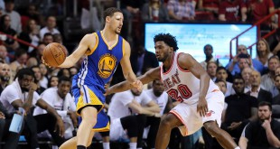 Feb 24, 2016; Miami, FL, USA; Golden State Warriors guard Klay Thompson (11) is pressured by Miami Heat forward Justise Winslow (20) during the second half at American Airlines Arena. Mandatory Credit: Steve Mitchell-USA TODAY Sports