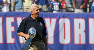 Sep 20, 2015; East Rutherford, NJ, USA; Former New York Giants head coach Bill Parcells carries the Vince Lombardi trophy from Super Bowl XXV during half time ceremony honoring the 25th anniversary of their championship at MetLife Stadium. Mandatory Credit: Ed Mulholland-USA TODAY Sports