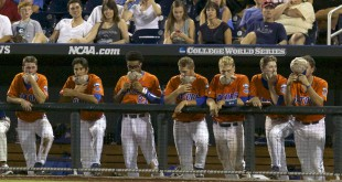 Jun 20, 2015; Omaha, NE, USA; Florida Gators players hold their hats in front of their faces against the Virginia Cavaliers in the ninth inning at the 2015 College World Series at TD Ameritrade Park. Virginia won 5-4. Mandatory Credit: Bruce Thorson-USA TODAY Sports