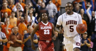 Jan 19, 2016; Auburn, AL, USA; Auburn Tigers forward Cinmeon Bowers (5) celebrates after grabbing a rebound as time expired defeating Alabama Crimson Tide 83-77 at Auburn Arena. Mandatory Credit: John Reed-USA TODAY Sports