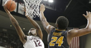 Jan 23, 2016; College Station, TX, USA; Texas A&M Aggies guard Jalen Jones (12) shoots against Missouri Tigers forward Kevin Puryear (24) in the second half at Reed Arena. Aggies won 66-53. Mandatory Credit: Thomas B. Shea-USA TODAY Sports