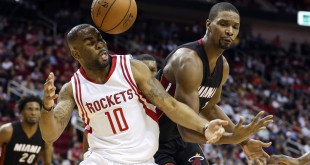 Feb 2, 2016; Houston, TX, USA; Houston Rockets forward Marcus Thornton (10) and Miami Heat forward Chris Bosh (1) battle for a loose ball during the third quarter at Toyota Center. The Rockets won 115-102. Mandatory Credit: Troy Taormina-USA TODAY Sports
