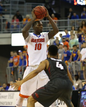 Feb 3, 2016; Gainesville, FL, USA; Florida Gators forward Dorian Finney-Smith (10) looks to pass the ball as Arkansas Razorbacks guard Jabril Durham (4) defends in the second half at Stephen C. O'Connell Center. The Florida Gators won 87-83. Mandatory Credit: Logan Bowles-USA TODAY Sports
